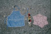 Mekapal (head belt), apron, and a small table rug