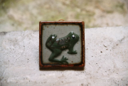 Ceramic decoration with a frog image