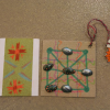 Self-made bookmarker and tiny tic-tac-toe game