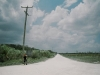 our hitchhiking spot on the crossroad to Progresso and Copper Bank; the only shadow is the poll