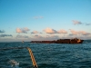Sugar cane barge passing in the ocean