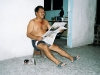 Edgar loves to read newspaper half-naked, sitting in front of his house in the evenings