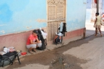 cooking in a side street - a picture of us became a Cuban sovenir for two French