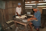 Aquilles Caranza and his grandson preparing all the bread manually