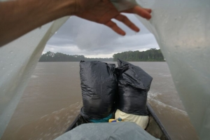 rain made this trip real fun! the trash backs in front of the boat are actually two Peruvian boys