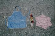 Mekapal (head belt), apron, and a small table rug