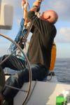repairing the loosened main sail